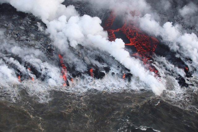 A lava flow from Hawaii's Kilauea Volcano enters the ocean near Isaac Hale Beach Park on August 5, 2018.