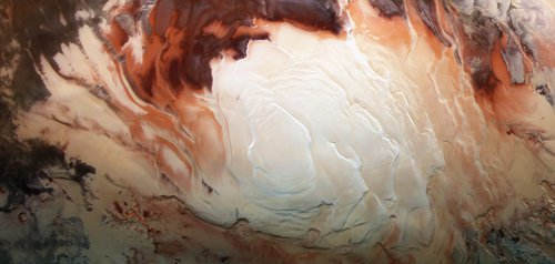 The bright white region of this image shows the icy cap that covers Mars' south pole, composed of frozen water and frozen carbon dioxide.