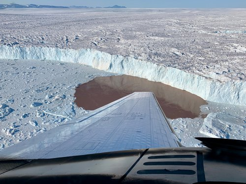 To measure water depth and salinity, the OMG project dropped probes by plane into fjords along Greenland's coast.