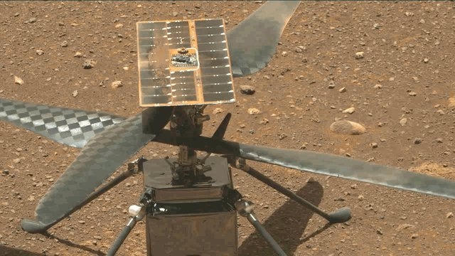 The Ingenuity Mars Helicopter's carbon fiber blades can be seen in this video screenshot taken by the Mastcam-Z instrument aboard NASA's Perseverance Mars rover on April 8, 2021, the 48th Martian day, or sol, of the mission.