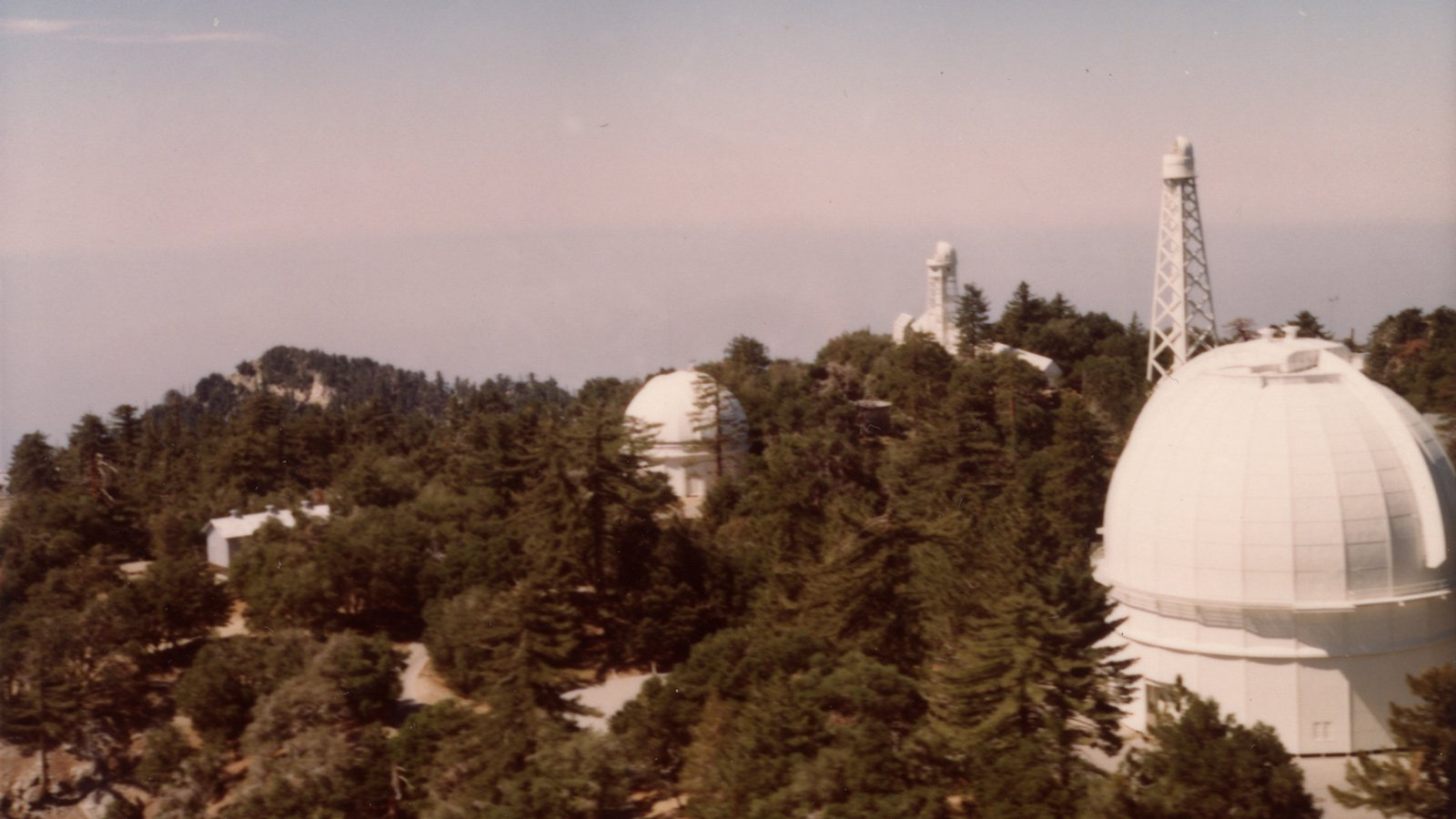 The Mount Wilson 60-inch and 100-inch telescopes. Credit: Image courtesy of the Observatories of the Carnegie Institution for Science Collection at the Huntington Library