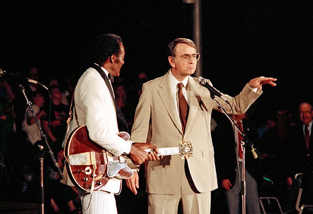 Chuck Berry (left) and Carl Sagan (right)