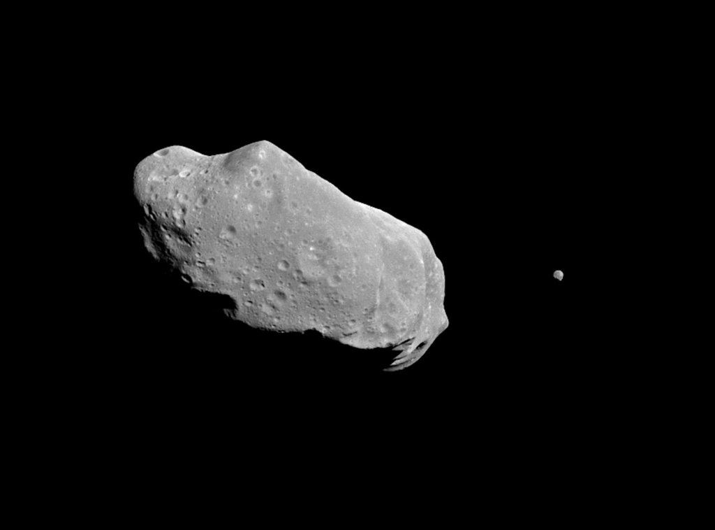 This is the first full picture showing both asteroid 243 Ida and its newly discovered moon to be transmitted to Earth NASA's Galileo spacecraft -- the first conclusive evidence that natural satellites of asteroids exist.