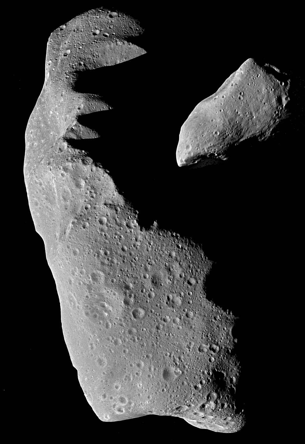 This picture shows the asteroids Ida (left) and Gaspra (right) to the same scale. These images were taken by NASA's Galileo spacecraft while enroute to Jupiter. Gaspra was imaged on October 29, 1991 at a range of 3,300 miles (5,300 km).
