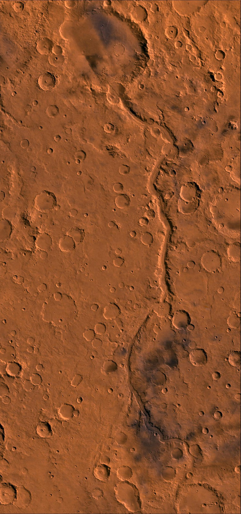 Ma'adim Vallis region of Mars. This image shows the 600-km-long channel that drained into impact crater Gusev. Crater Gusev is about 160 km in diameter, as seen by NASA's Viking spacecraft.