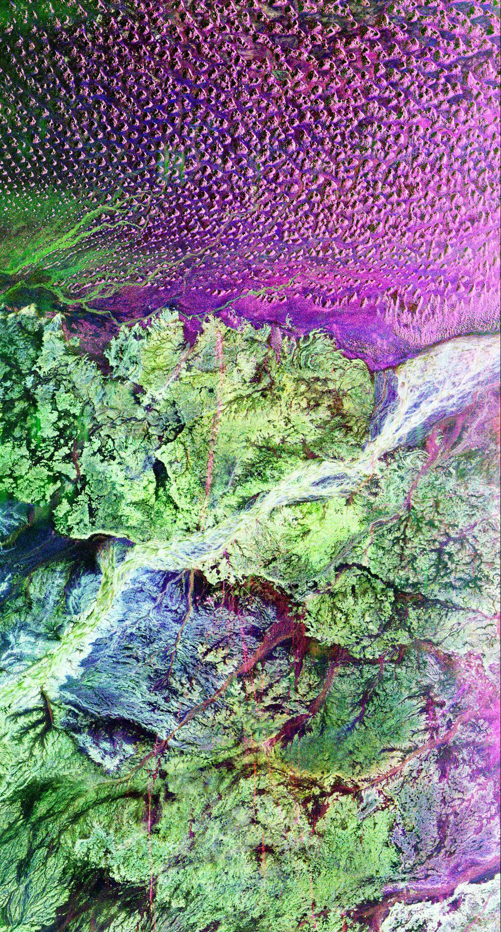 This is a radar image of the region around the site of the lost city of Ubar in southern Oman, on the Arabian Peninsula from NASA's Spaceborne Imaging Radar C/X-Band Synthetic Aperture Radar.