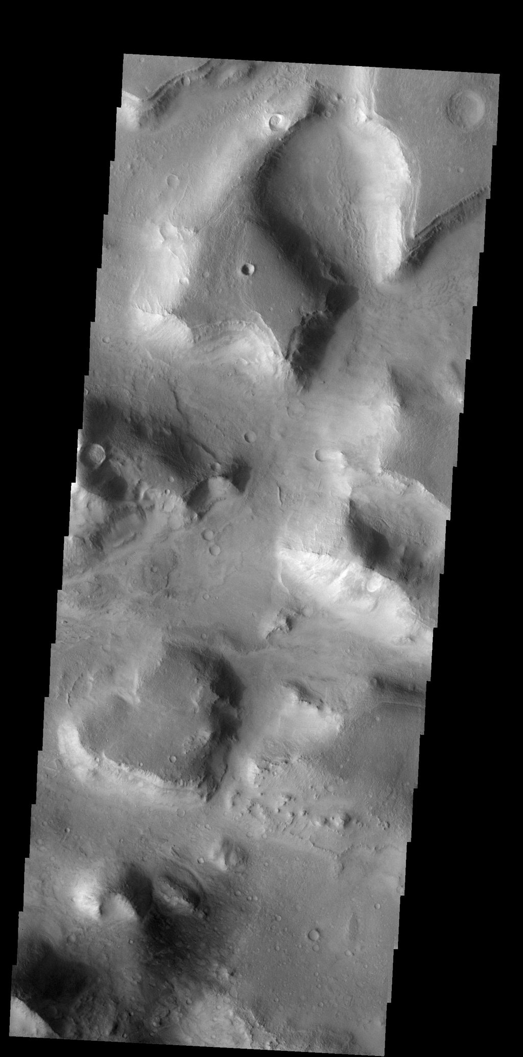 This isolated mesa has an almost heart-shaped margin. Happy Valentine's Day from Mars as seen by NASA's 2001 Mars Odyssey.