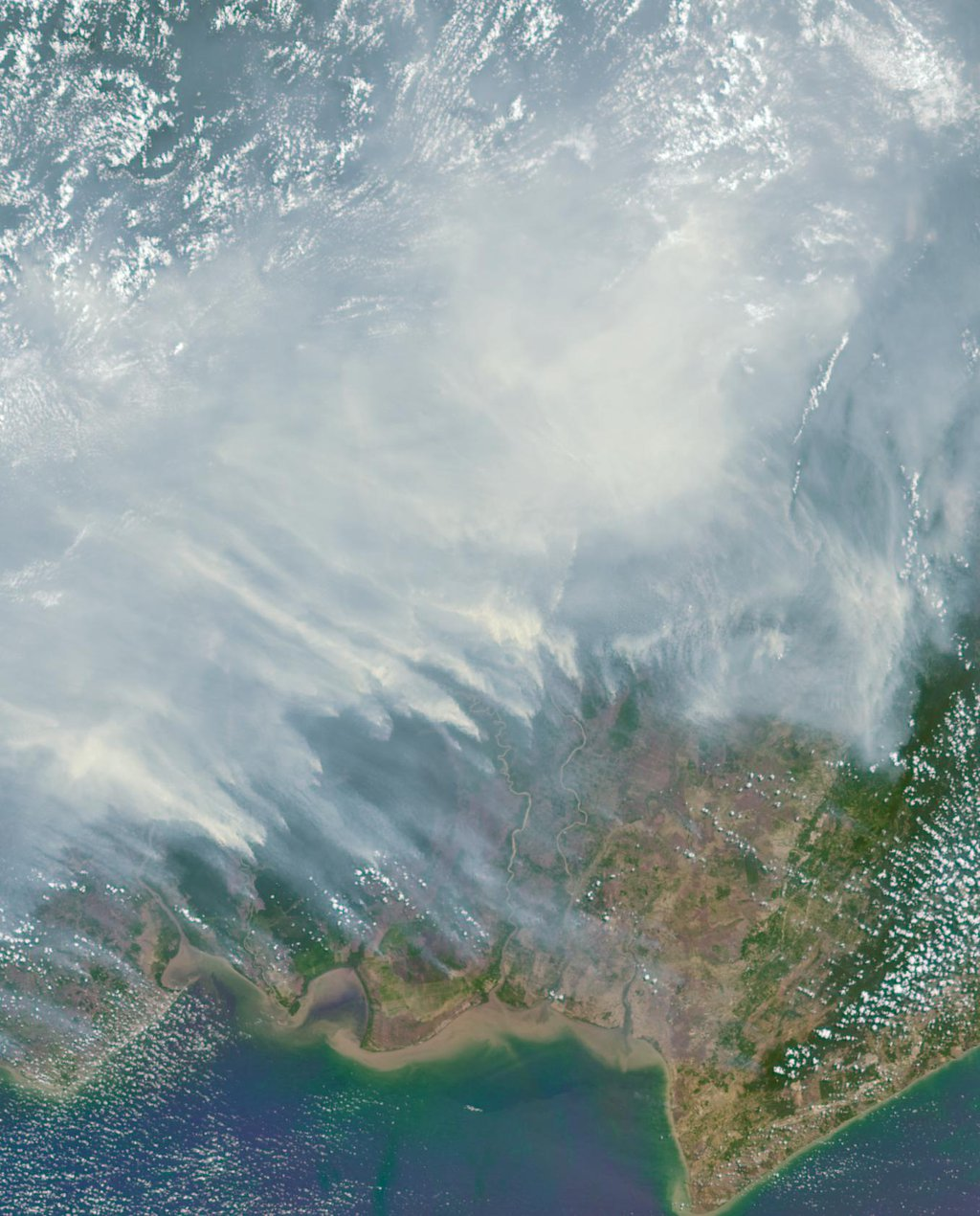 The worst forest fires in nearly two decades are burning out of control on Borneo, creating the thick blanket of smoke in this Oct. 14, 2015 image from NASA's Terra spacecraft.