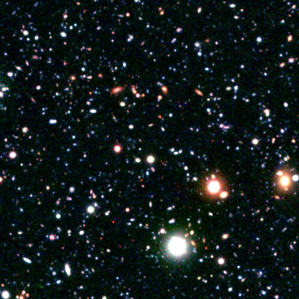 Astronomers have discovered a massive cluster of young galaxies forming in the distant universe. The growing galactic metropolis is known as COSMOS-AzTEC3. This image was taken Japan's Subaru telescope atop Mauna Kea in Hawaii.