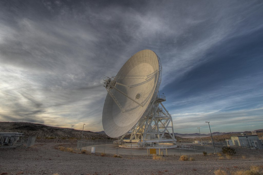 Goldstone's 111.5-foot (34-meter) Beam Waveguide tracks a spacecraft as it comes into view. The Goldstone Deep Space Communications Complex is located in the Mojave Desert in California, USA.