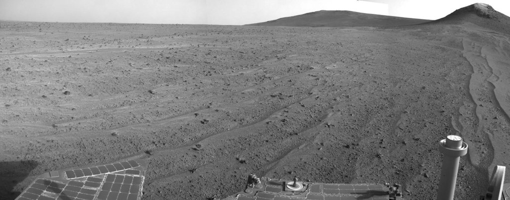NASA's Mars rover Opportunity captured this view southward just after completing a 338-foot (103-meter) southward drive, in reverse, on Aug. 10, 2014. The foreground of this view from the rover's Navcam includes the rear portion of the rover's deck.