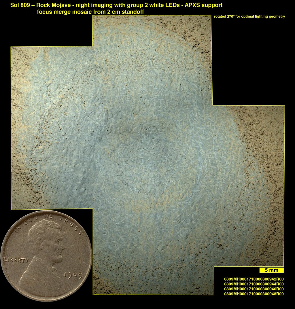 Lozenge-shaped crystals are evident in this magnified view of a Martian rock target called 'Mojave,' taken on Nov. 15, 2014, by NASA's Curiosity Mars rover. These features record concentration of dissolved salts, possibly in a drying lake.