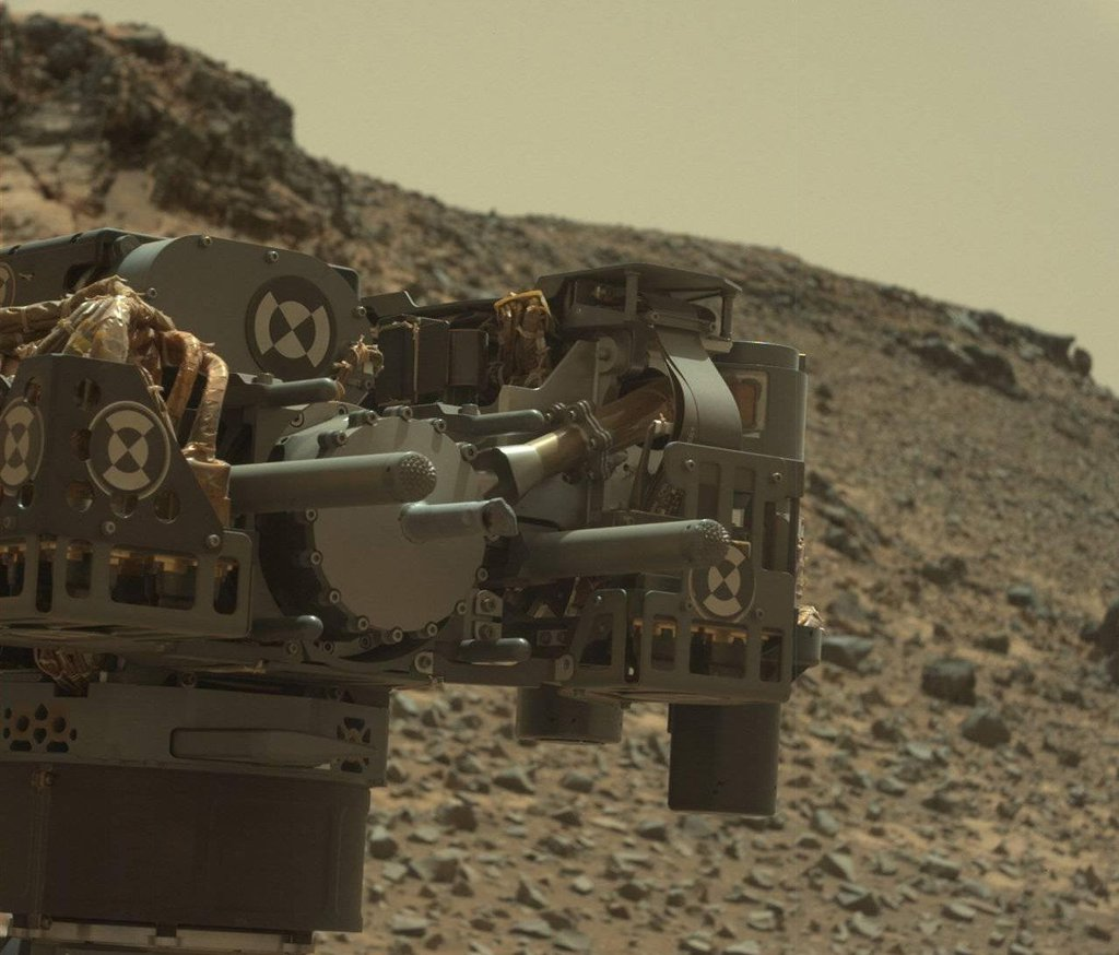 This raw-color view from Curiosity's Mastcam shows the rover's drill just after finishing a drilling operation at 'Telegraph Peak' on Feb. 24, 2015.
