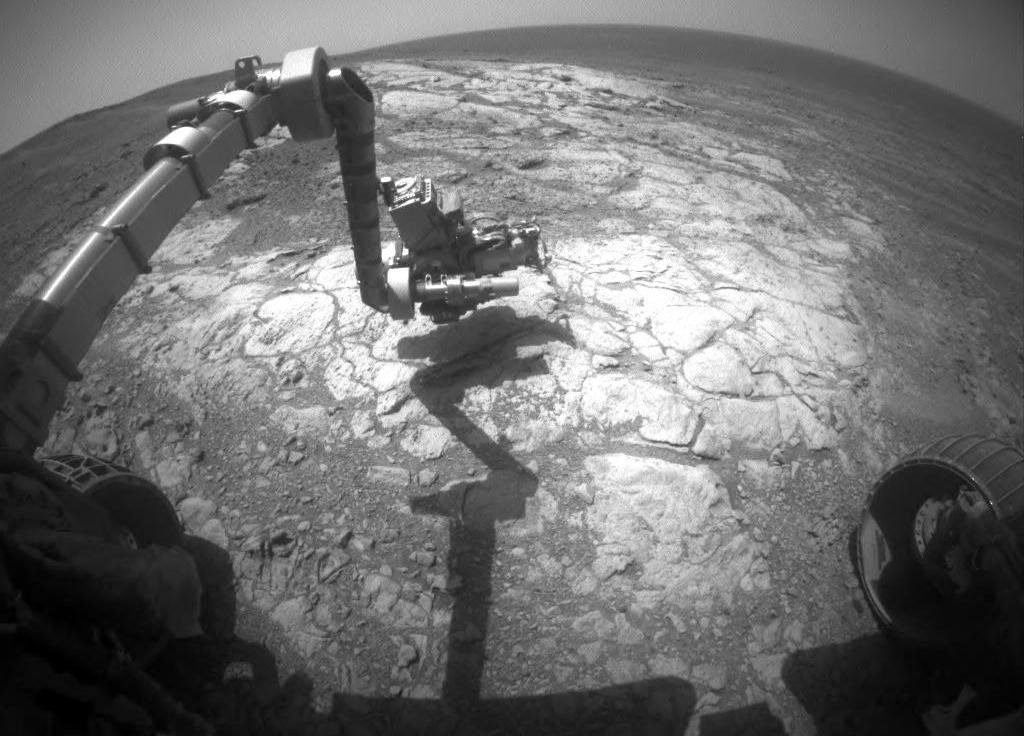 NASA's Mars Exploration Rover Opportunity has extended its robotic arm for studying a light-toned rock target called 'Athens' in this March 25, 2015, image from the rover's front hazard avoidance camera.