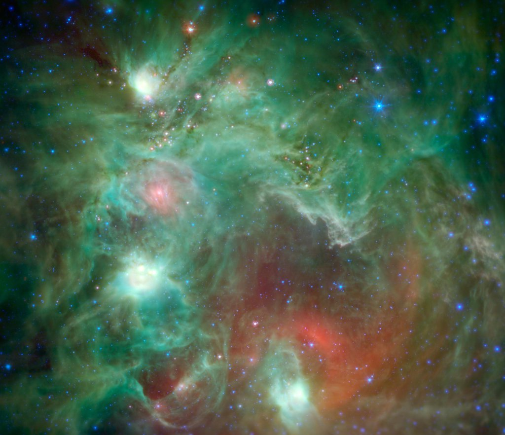 Scores of baby stars shrouded by dust are revealed in this infrared image of the star-forming region NGC 2174, as seen by NASA's Spitzer Space Telescope. Found in the constellation Orion, NGC 2174 is located around 6,400 light-years away.