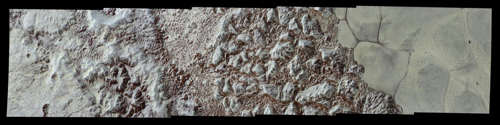 This image from NASA's New Horizons forms a strip trending from the edge of 'badlands' northwest of Sputnik Planum, across the al-Idrisi mountains, onto the shoreline of Pluto's 'heart' feature, and just into its icy plains.