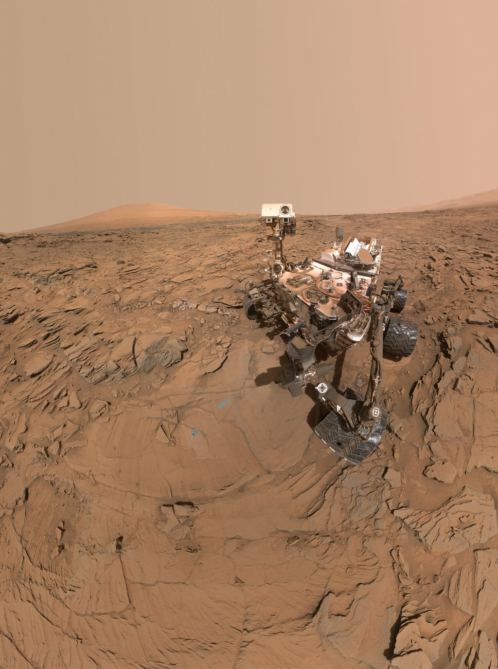 This self-portrait of NASA's Curiosity Mars rover shows the vehicle at a drilled sample site called 'Okoruso,' on the 'Naukluft Plateau' of lower Mount Sharp.