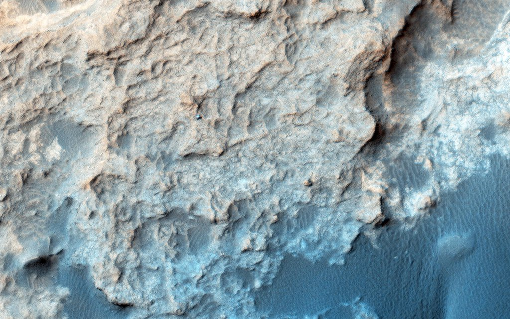 This image from NASA's Mars Reconnaissance Orbiter spacecraft shows the Curiosity rover currently located on the Naukluft Plateau just north of the Bagnold Dune field.