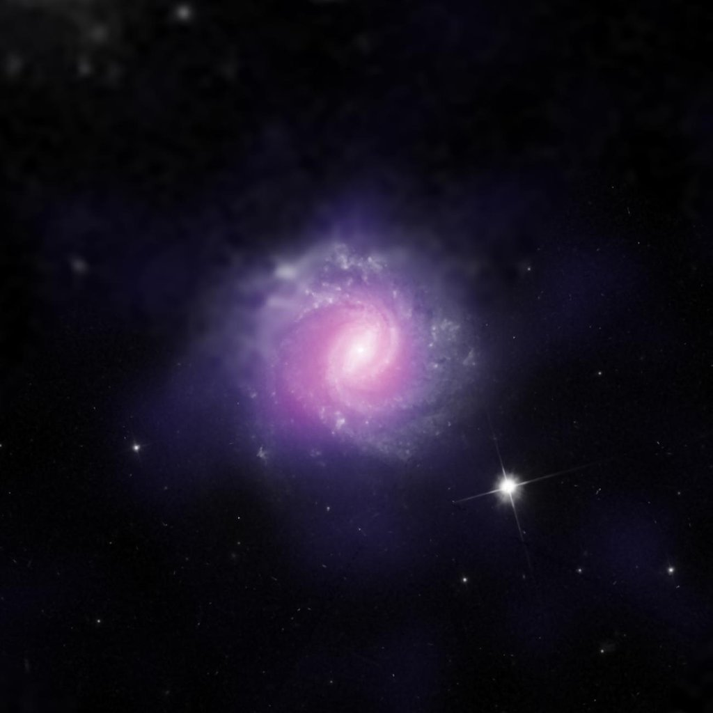 IC 3639, a galaxy with an active galactic nucleus, is seen in this image combining data from NASA's Hubble Space Telescope and the European Southern Observatory.