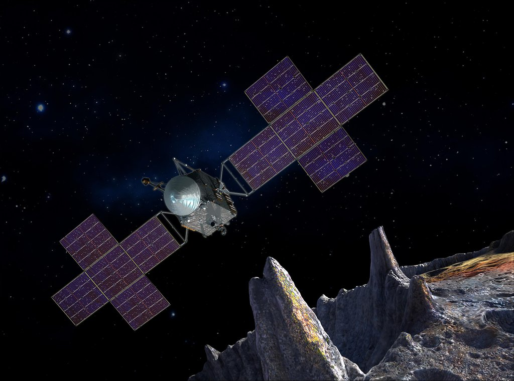 This artist's-concept illustration depicts the spacecraft of NASA's Psyche mission near the mission's target, the metal asteroid Psyche. The artwork was created in May 2017 to show the five-panel solar arrays planned for the spacecraft.