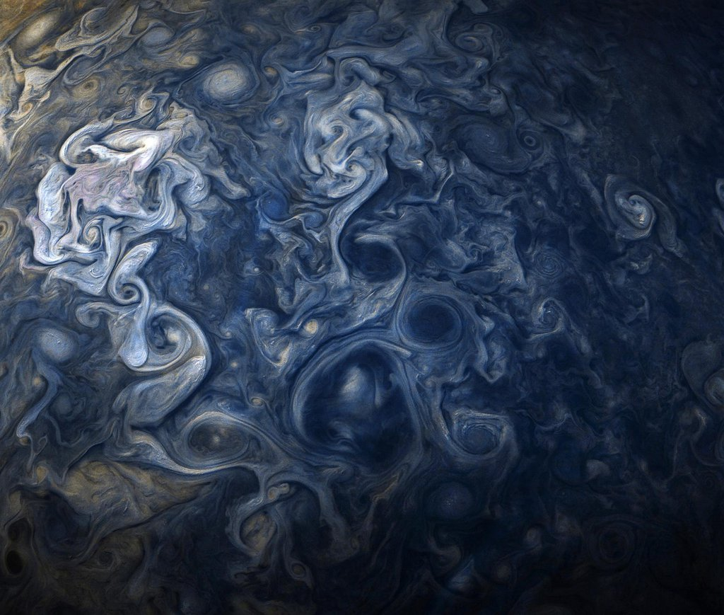 Jovian clouds in striking shades of blue are evident in this view taken by NASA's Juno spacecraft on Oct. 24, 2017.