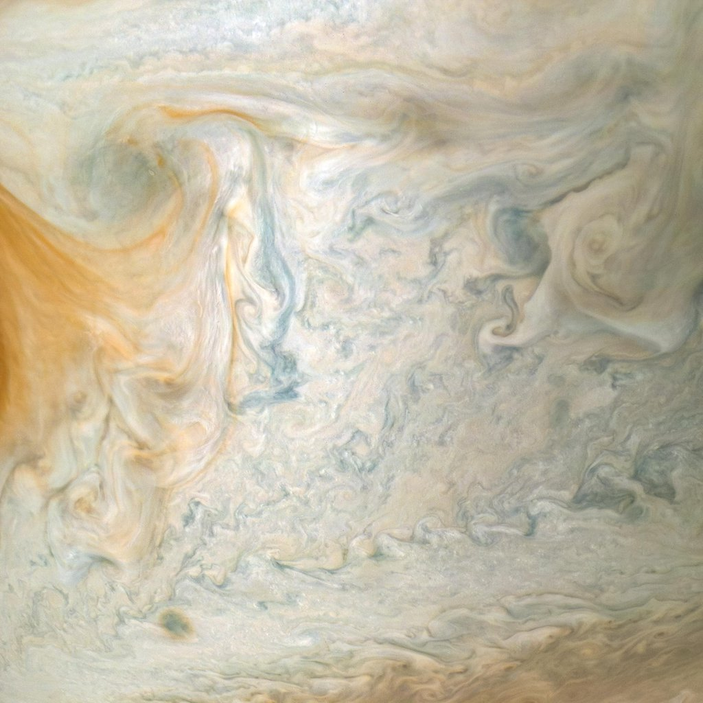 The easternmost edge of Jupiter's Great Red Spot and surrounding south tropical disturbance are captured in this image from NASA's Juno spacecraft.