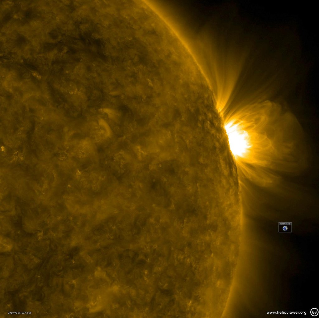 NASA's Solar Dynamics Observatory observed giant, bright coronal loops trace out the magnetic field lines above an active region from June 4-6, 2018.