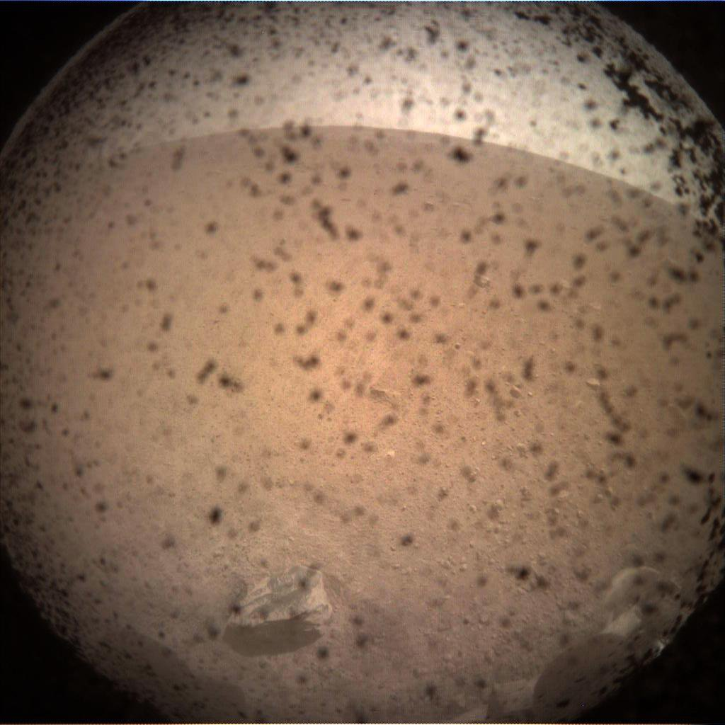 This is the first image taken by NASA's InSight lander on the surface of Mars on Nov. 26, 2018.