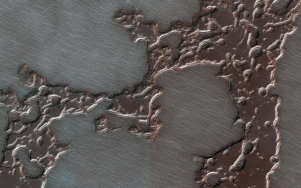 This image acquired on August 20, 2018 by NASA's Mars Reconnaissance Orbiter, shows remnants of a deposit, composed of dry ice layered together with dust and water ice, that form the south polar residual cap.