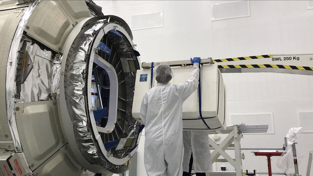 This image shows NASA's Cold Atom Laboratory, packaged in a protective layer, being loaded up onto a Northrop Grumman (formerly Orbital ATK) Cygnus spacecraft for its trip to the International Space Station.