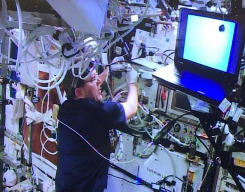 This image shows astronaut Ricky Arnold assisting with the installation of NASA's Cold Atom Laboratory on the International Space Station.