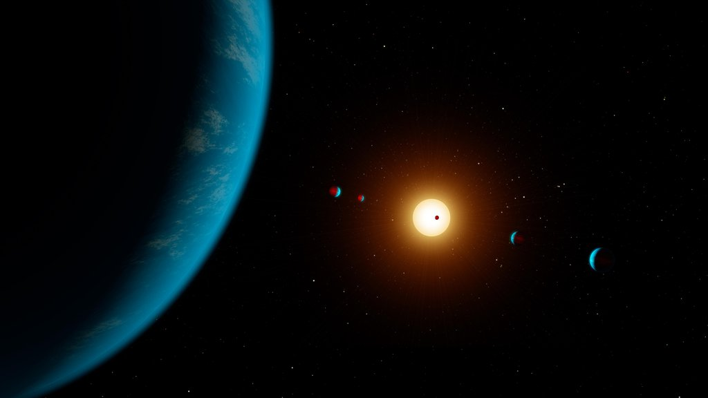 This artist's illustration shows the planetary system K2-138. Five planets were initially detected in the system but in 2018 scientists found evidence of a sixth planet.
