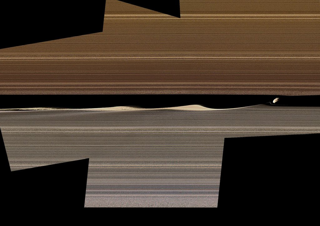 NASA's Cassini spacecraft shows this enhanced-color image mosaic of Daphnis, one of the moons embedded in Saturn's rings.