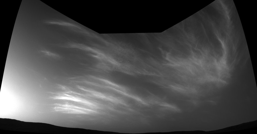NASA's Curiosity Mars rover imaged these drifting clouds on May 17, 2019, the 2,410th Martian day, or sol, of the mission, using its Navigation Cameras (Navcams).