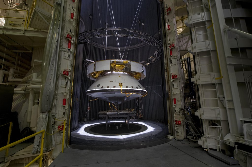The completed spacecraft that will carry the Mars 2020 rover to the Red Planet, next year hangs suspended by cables inside the Space Simulator Facility at NASA's Jet Propulsion Laboratory in Pasadena, California. The image was taken on May 9, 2019.