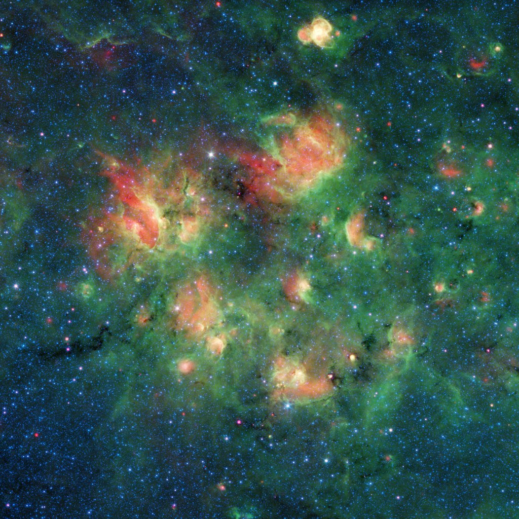 This infrared image from NASA's Spitzer Space Telescope shows a cloud of gas and dust full of bubbles, which are inflated by wind and radiation from massive young stars.