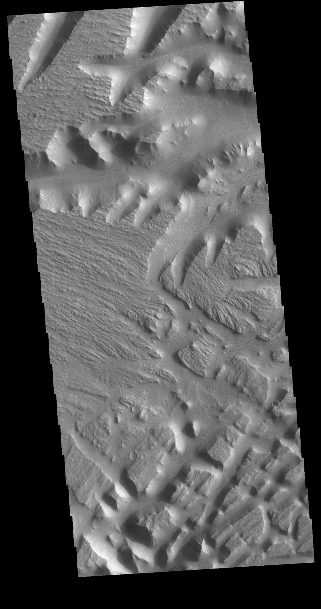 This image from NASA's Mars Odyssey shows part of Nilus Mensae, a complex region of tectonic faulting and fluid flow features.