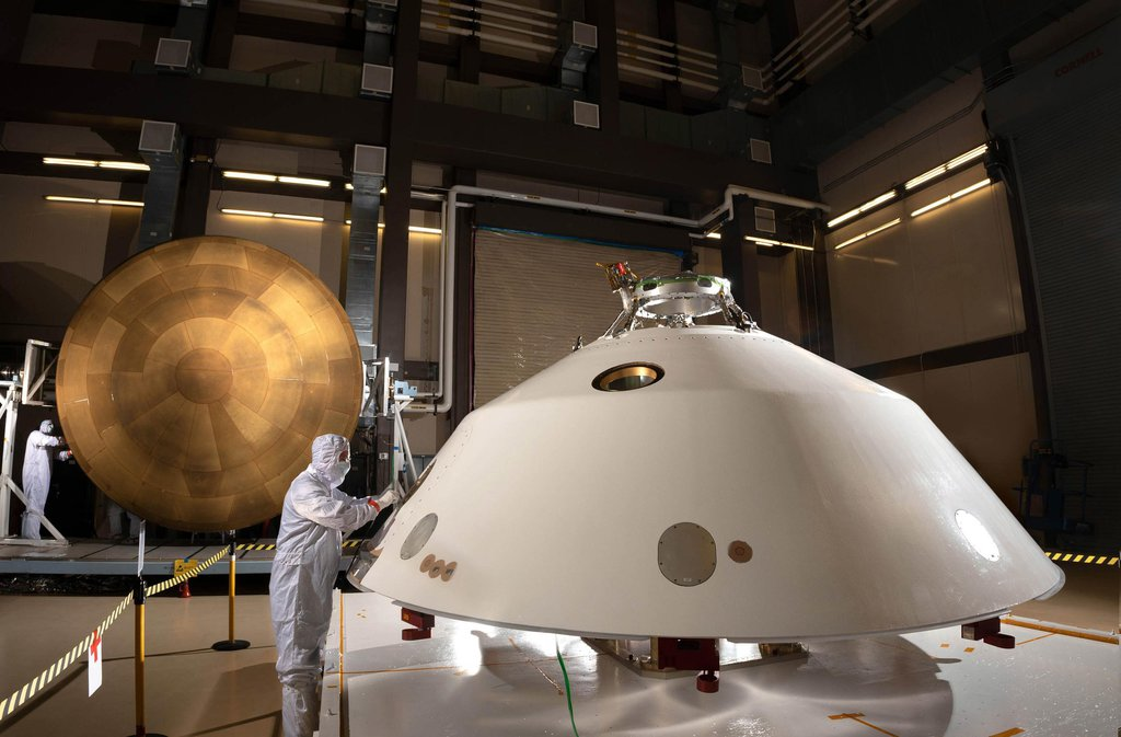 The heat shield (left) and back shell (right) that comprise the aeroshell for NASA's Mars 2020 mission are depicted in this image.