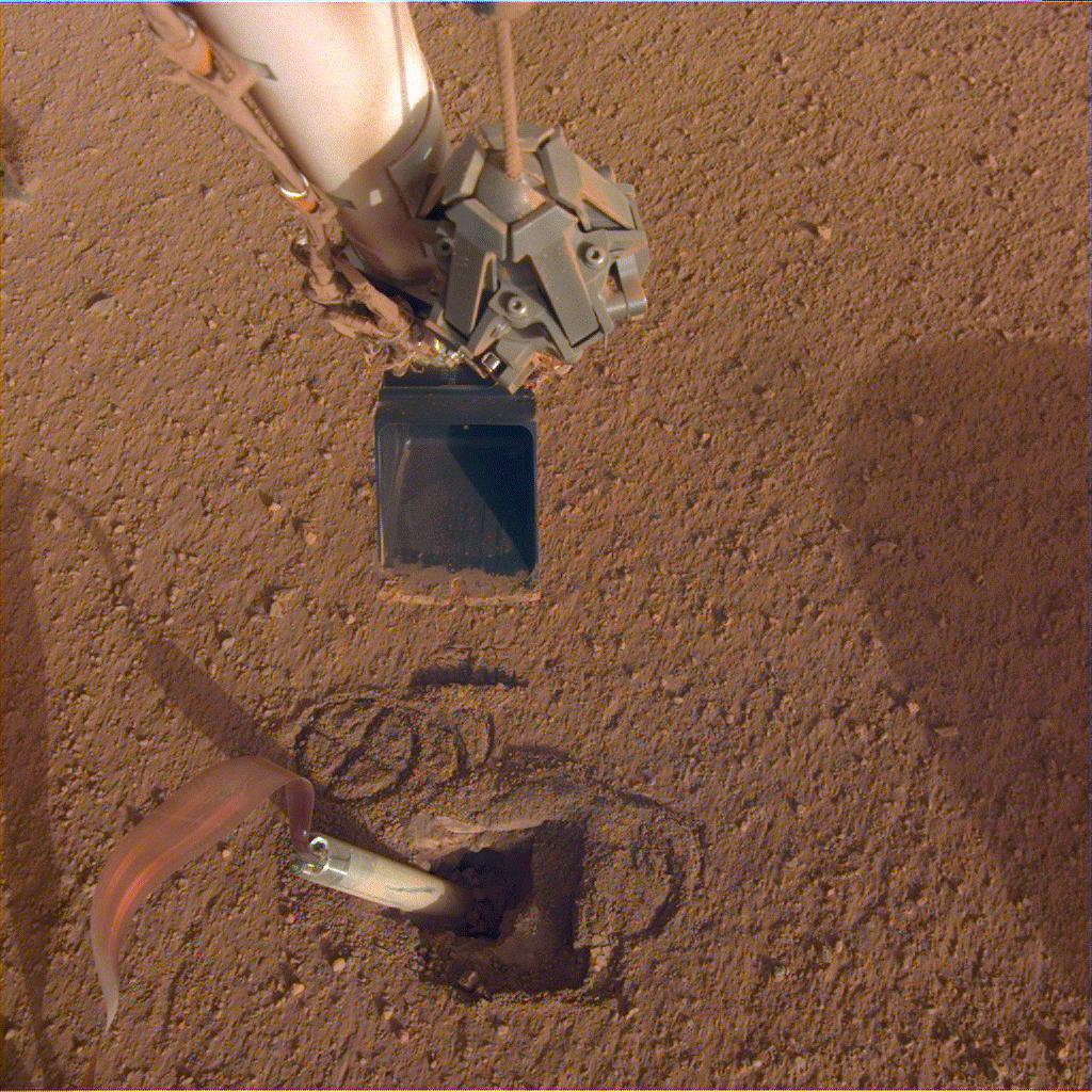 InSight recently moved its robotic arm closer to its digging device, called the mole, in preparation to push on its top, or back cap.