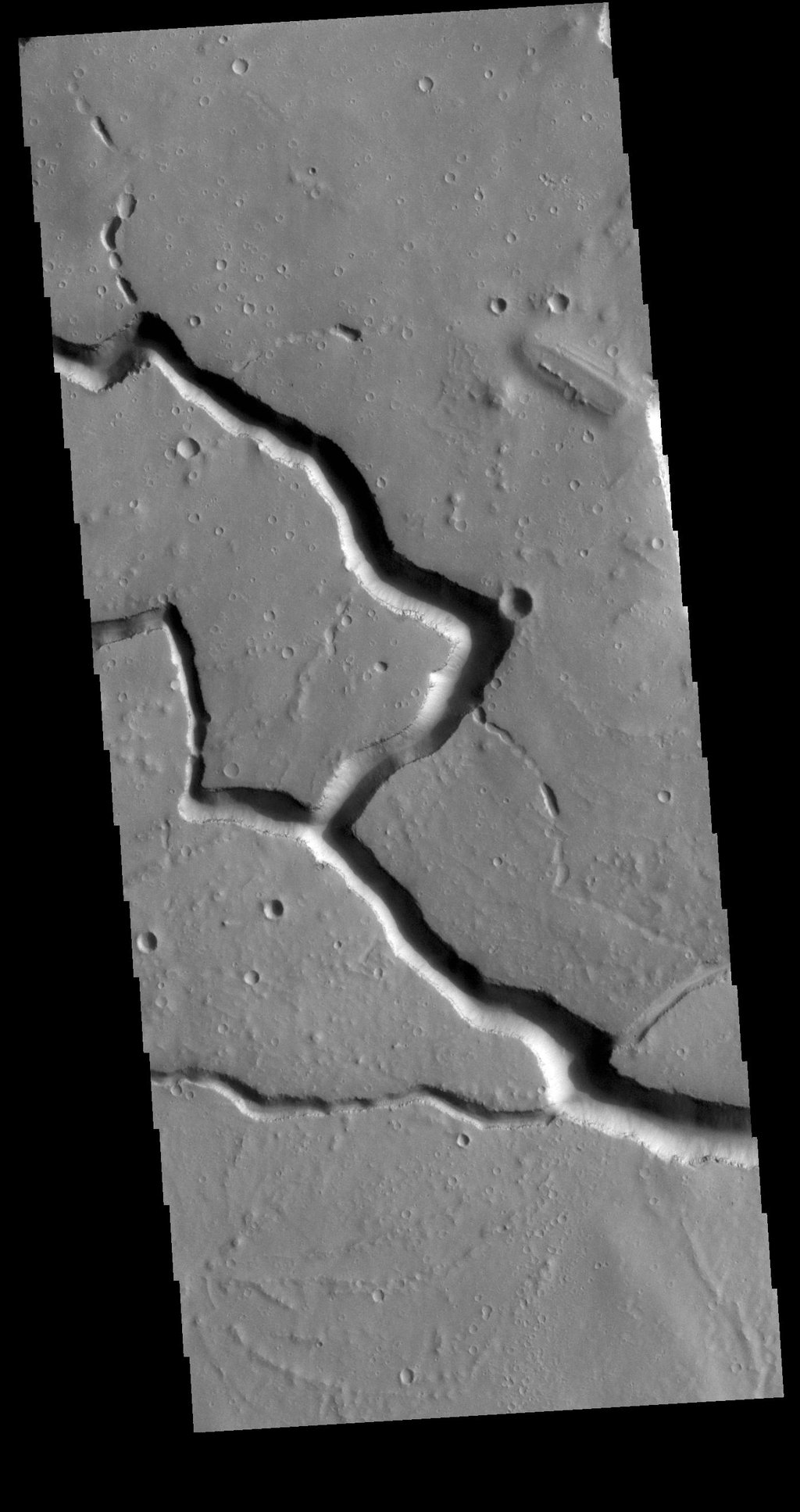 This image from NASA's Mars Odyssey shows the central portion of Hephaestus Fossae.