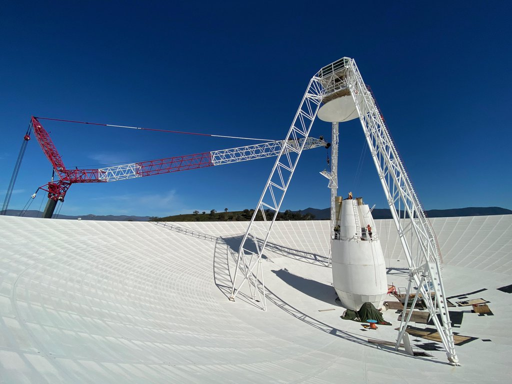 Workers perform upgrades on the central cone of the Deep Space Network's Deep Space Station 43's antenna in Canberra, Australia. Improvements on the dish, which spans 70 meters (239 feet) are expected to be complete by January 2021.