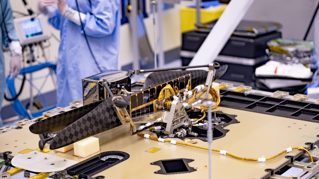 The Mars Helicopter and its Mars Helicopter Delivery System were attached to the Perseverance Mars rover at Kennedy Space Center on April 6, 2020.