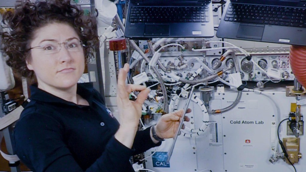 Astronaut Christina Koch assists with a hardware upgrade for NASA's Cold Atom Lab aboard the International Space Station in January 2020.