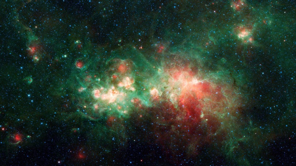 This image from NASA's Spitzer Space telescope shows the star-forming nebula W51, one of the largest star factories in the Milky Way galaxy.