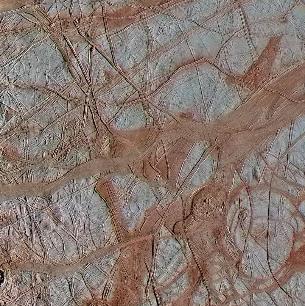The surface of Jupiter's moon Europa features a widely varied landscape, including ridges, bands, small rounded domes and disrupted spaces that geologists called chaos terrain.