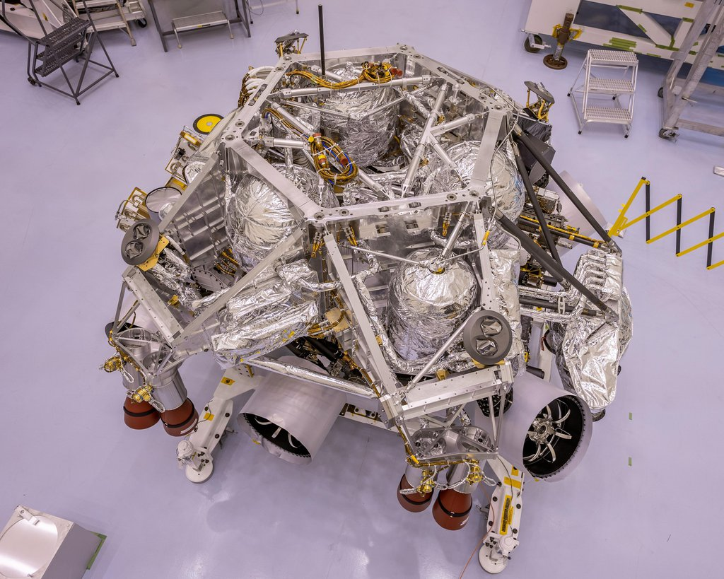 This image of the rocket-powered descent stage sitting on to of NASA's Perseverance rover was taken in a clean room at Kennedy Space Center on April 29, 2020.
