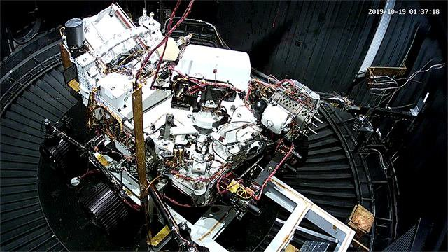 This animated GIF shows the deployment of the Perseverance rover's remote sensing mast during a cold test in a space simulation chamber at NASA's Jet Propulsion Laboratory.
