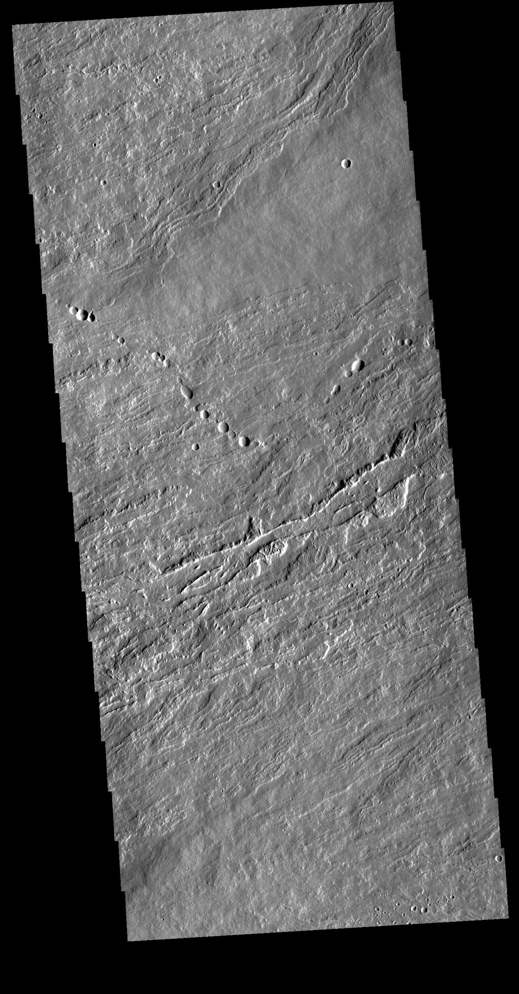 This image from NASA's Mars Odyssey shows flank flows on the east side of Olympus Mons.