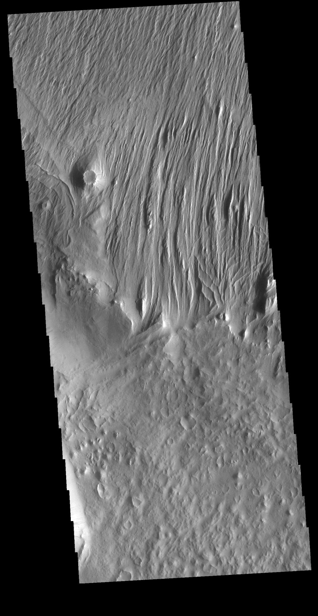 This image from NASA's Mars Odyssey shows evidence of long term wind action and erosion east of Eumenides Dorsum.