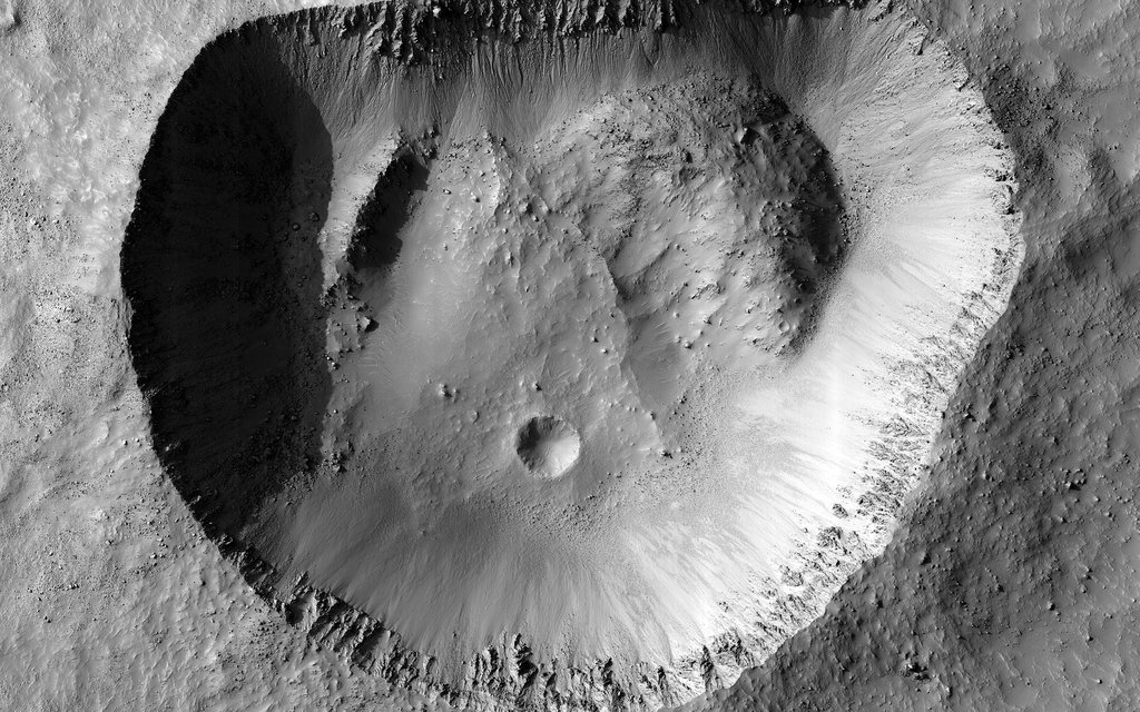 This image acquired on April 26, 2020 by NASA's Mars Reconnaissance Orbiter, shows the crisp detail of a crater rim.